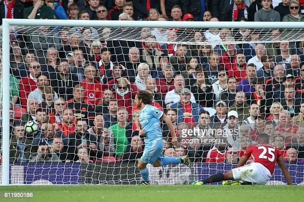 Stoke City's Welsh midfielder Joe Allen celebrates after he scores Stoke's equalizer during the English Premier League football match between...
