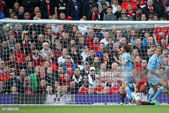 Stoke City's Welsh midfielder Joe Allen scores Stoke's equalizer during the English Premier League football match between Manchester United and Stoke...