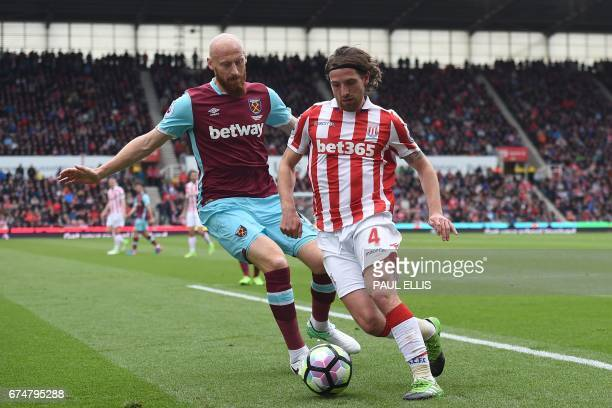 Stoke City's Welsh midfielder Joe Allen vies with West Ham United's Welsh defender James Collins during the English Premier League football match...