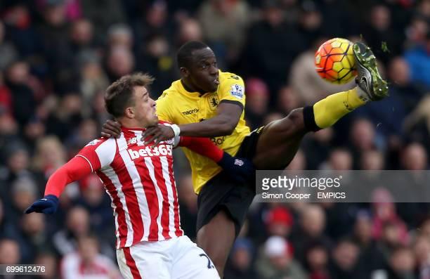 Stoke City's Xherdan Shaqiri and Aston Villa's Aly Cissokho battle for the ball