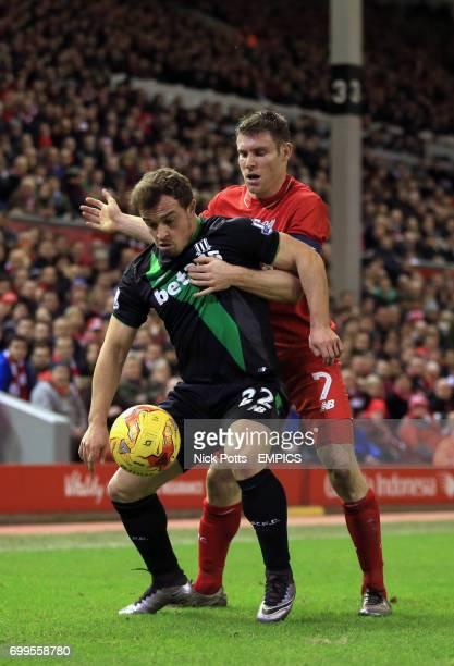 Stoke City's Xherdan Shaqiri and Liverpool's James Milner battle for the ball