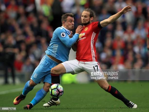 Stoke City's Xherdan Shaqiri and Manchester United's Daley Blind battle for the ball