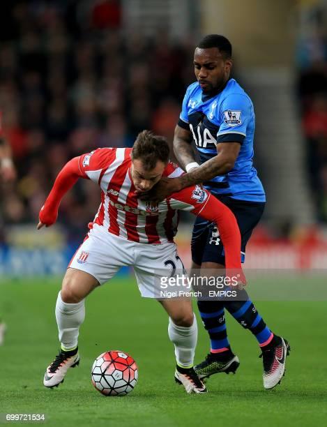 Stoke City's Xherdan Shaqiri and Tottenham Hotspur's Danny Rose battle for the ball