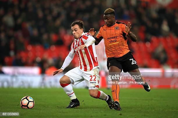 Stoke City's Xherdan Shaqiri and Wolverhampton Wanderers' Bright Enobakhare battle for the ball