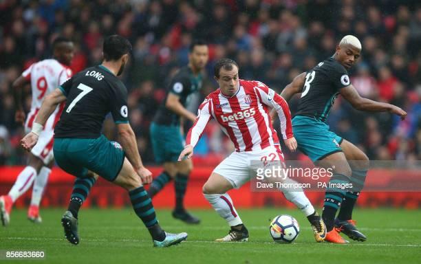 Stoke City's Xherdan Shaqiri Southampton's Shane Long and Southampton's Harrison Reed during the Premier League match at the bet365 Stadium Stoke