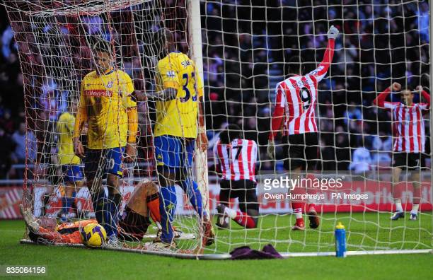 Stoke goal keeper Thomas Sorensen lies dejected after Sunderland's Kenwyne Jones scored during the Barclays Premier League match at the Stadium of...