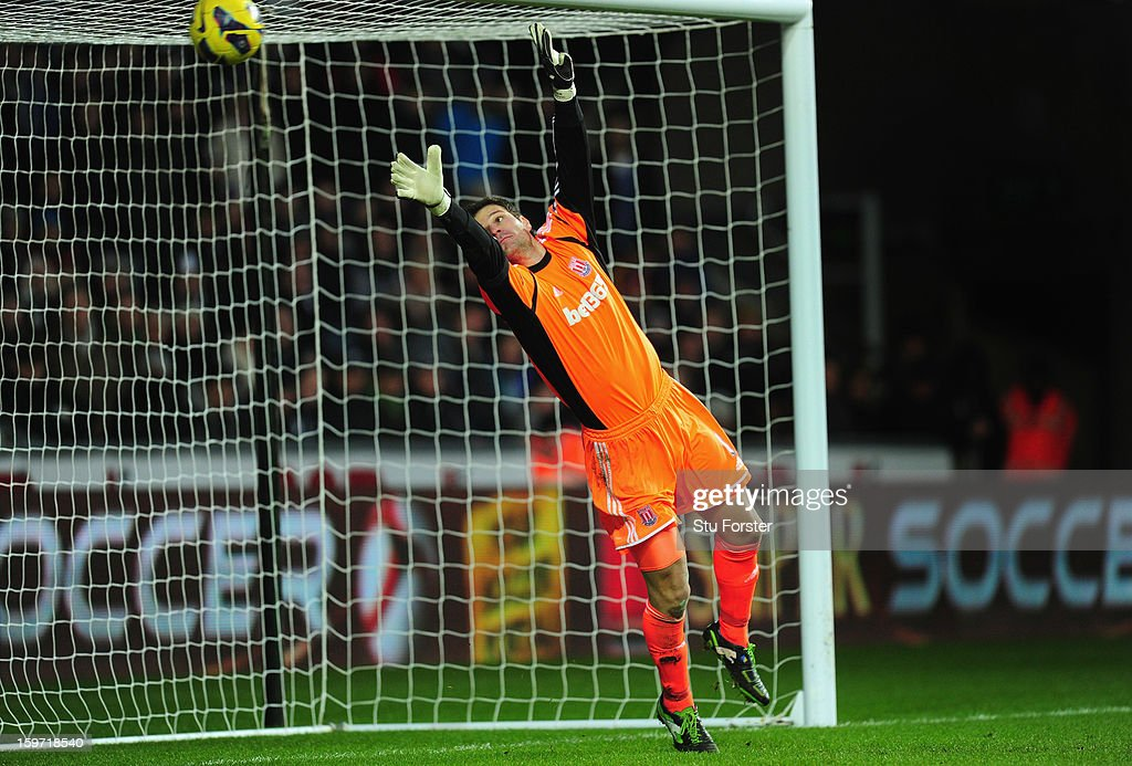 Stoke goalkeeper <a gi-track='captionPersonalityLinkClicked' href=/galleries/search?phrase=Asmir+Begovic&family=editorial&specificpeople=4184467 ng-click='$event.stopPropagation()'>Asmir Begovic</a> is beaten by Swansea player Jonathan de Guzman free kick for the second Swansea goal during the Barclays Premier League match between Swansea City and Stoke City at Liberty Stadium on January 19, 2013 in Swansea, Wales.
