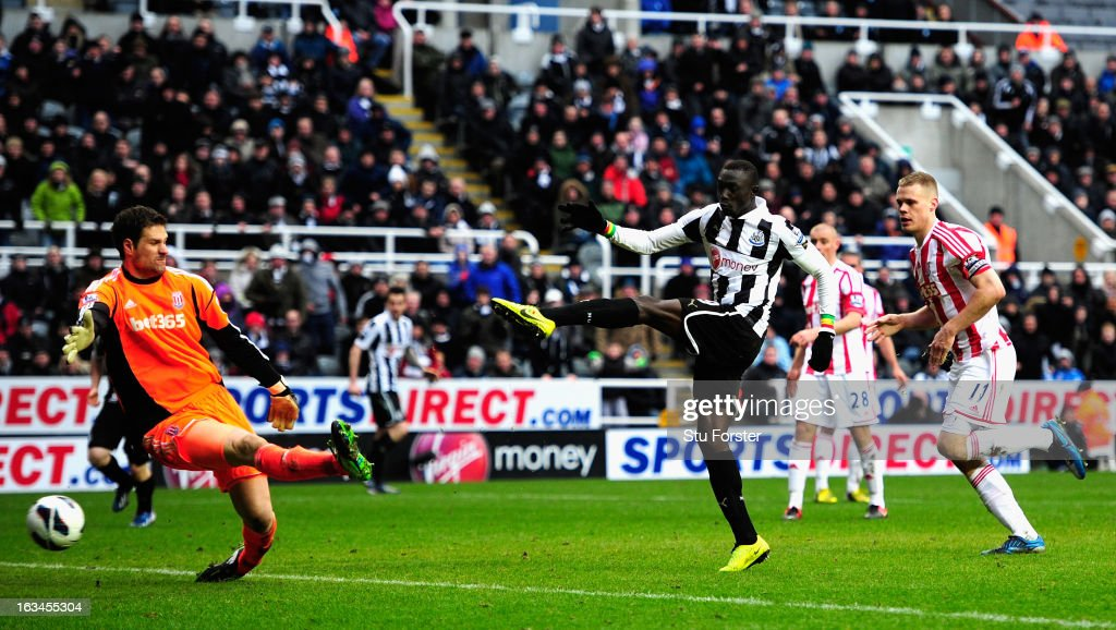 Stoke keeper Asmir Bergovic is beaten by Newcastle forward <a gi-track='captionPersonalityLinkClicked' href=/galleries/search?phrase=Papiss+Cisse&family=editorial&specificpeople=4251917 ng-click='$event.stopPropagation()'>Papiss Cisse</a> for the winning goal during the Barclays Premier League match between Newcastle United and Stoke City at St James' Park on March 10, 2013 in Newcastle upon Tyne, England.