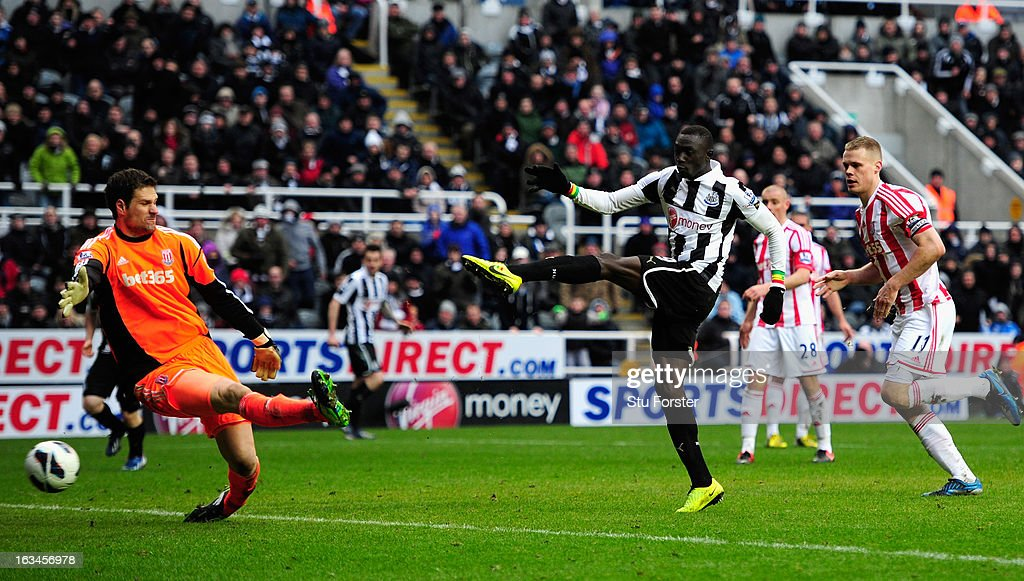 Stoke keeper Asmir Bergovic is beaten by Newcastle forward Papiss Cisse for the winning goal during the Barclays Premier League match between Newcastle United and Stoke City at St James' Park on March 10, 2013 in Newcastle upon Tyne, England.