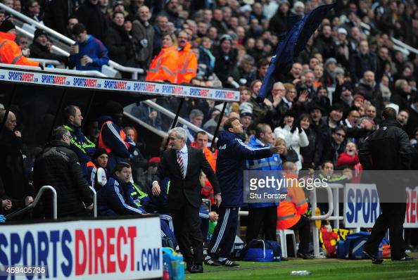 Stoke manager Mark Hughes throws his coat up in the air in disgust after being sent to the stands by referee Martin Atkinson during the Barclays...