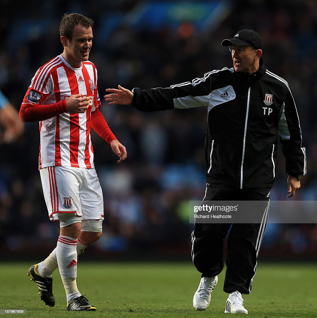 Stoke manager Tony Pulis pulls off Glenn Whelan as they walk down the tunnel at half time during the Barclays Premier League match between Aston Villa and Stoke City at Villa Park on December 8, 2012 in Birmingham, England.