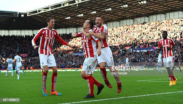 Stoke player Charlie Adam is congratulated by team mates after scoring during the Barclays Premier League match between Stoke City and Swansea City...