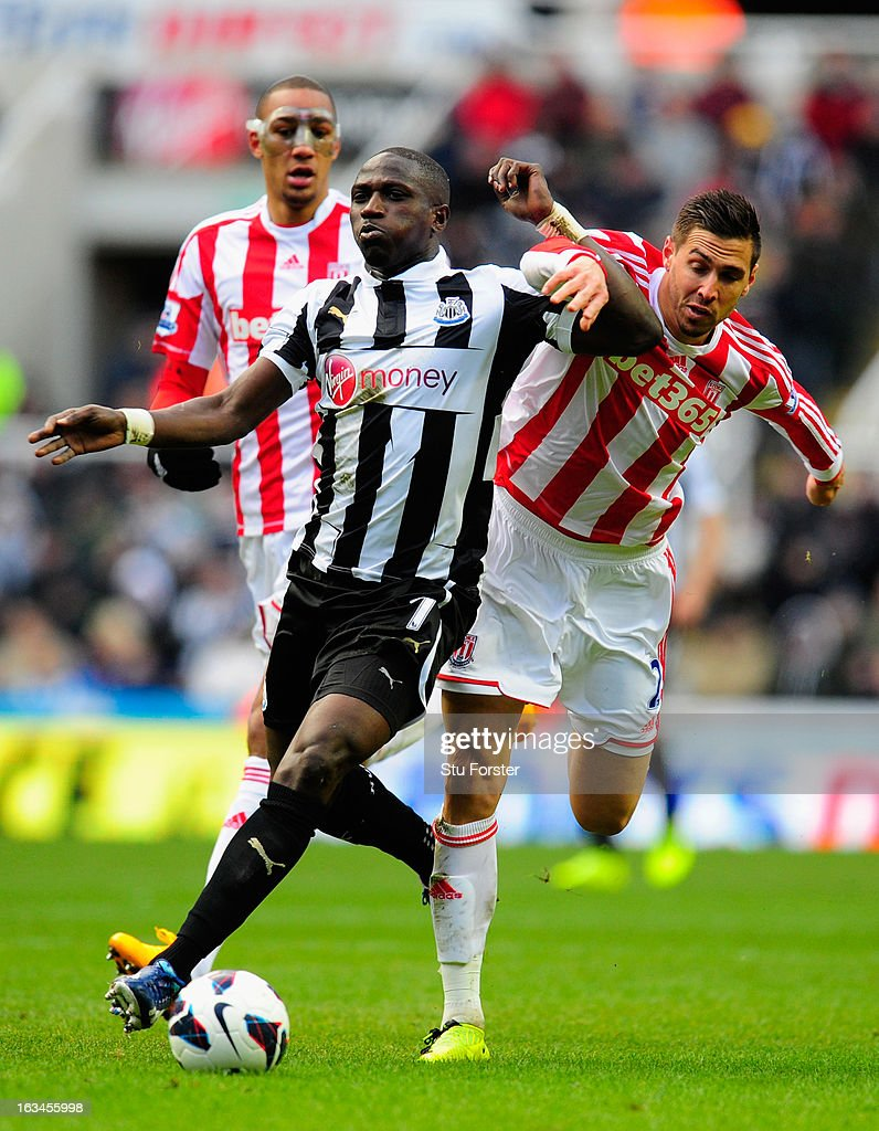 Stoke player Geoff Cameron (r) battles for the ball with Moussa Sissoko during the Barclays Premier League match between Newcastle United and Stoke City at St James' Park on March 10, 2013 in Newcastle upon Tyne, England.