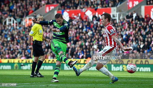 Stoke player Glenn Whelan looks on as Gylfi Sigurdsson of Swansea scores their first goal during the Barclays Premier League match between Stoke City...