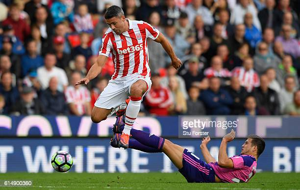 Stoke player Jonathan Walters skips the challenge of Javier Manquillo of Sunderland during the Premier League match between Stoke City and Sunderland...