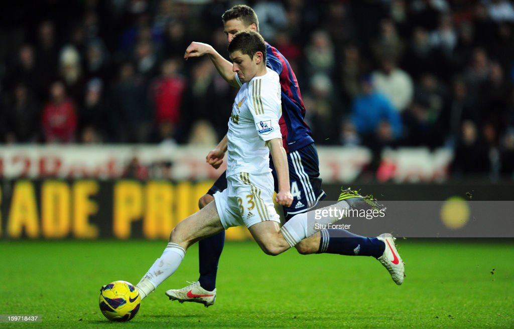 Stoke player Ryan Shawcross looks on as Swansea player Ben Davies fires in the first goal during the Barclays Premier League match between Swansea City and Stoke City at Liberty Stadium on January 19, 2013 in Swansea, Wales.