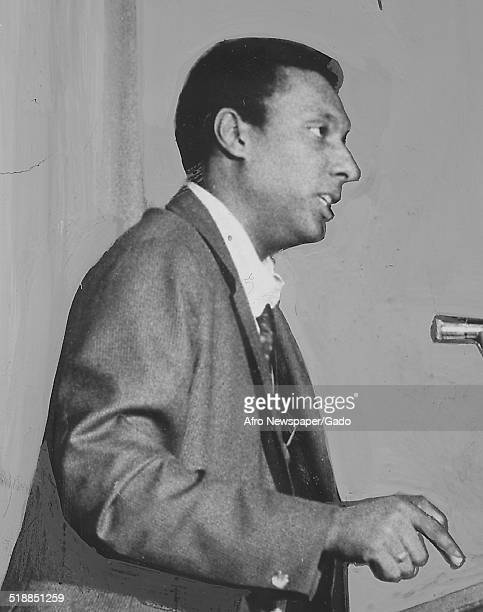 Stokely Carmichael speaking at a podium at Morgan State University Baltimore Maryland 1967