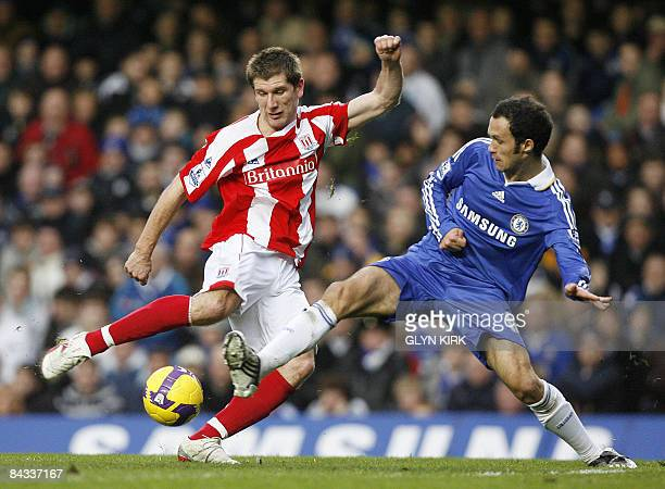 Stoke's English Striker Richard Cresswell vies with Chelsea's Portuguese Defender Ricardo Carvalho during their Premier League match against Chelsea...