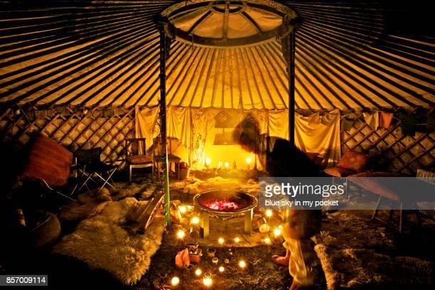 Stoking the fire in the healing yurt.
