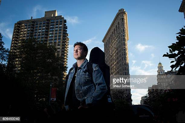 Stolar poses in front of New York's iconic Flatiron Building on his way to the studio Through his singing and songwriting Stolar expresses himself...