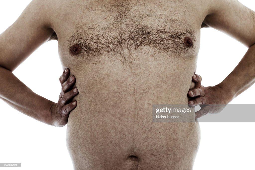 stomach of mature man : Stock Photo