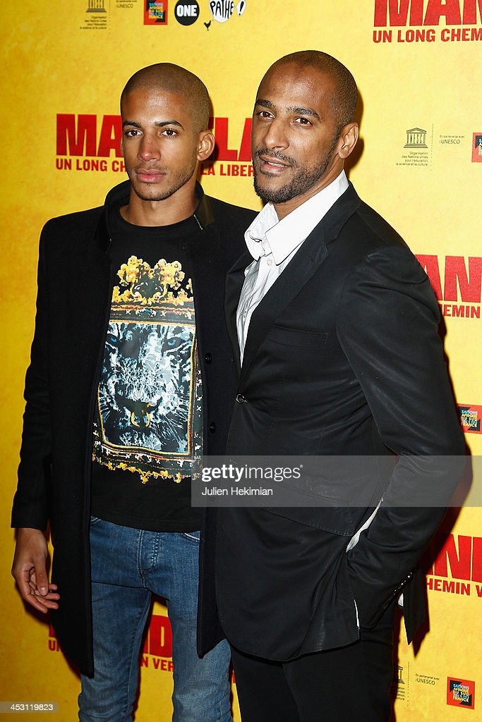 Stomy Bugsy (R) and his son Bilal Duarte attend 'Mandela : Long Walk to Freedom' Paris Premiere at UNESCO on December 2, 2013 in Paris, France.