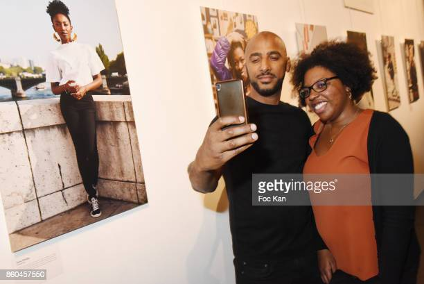 Stomy Bugsy poses for a selfie with a fan during the 'Afro' Rokhaya Diallo and photographer Brigitte Sombie Exhibition at Maison des Metallos on...