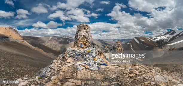 Stone and prayer flag with Himalayas mountain range