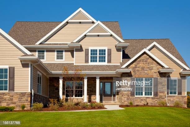 Stone and Vinyl House With Cedar Accents