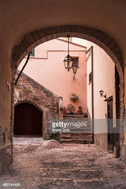 Stone archway to courtyard and steps