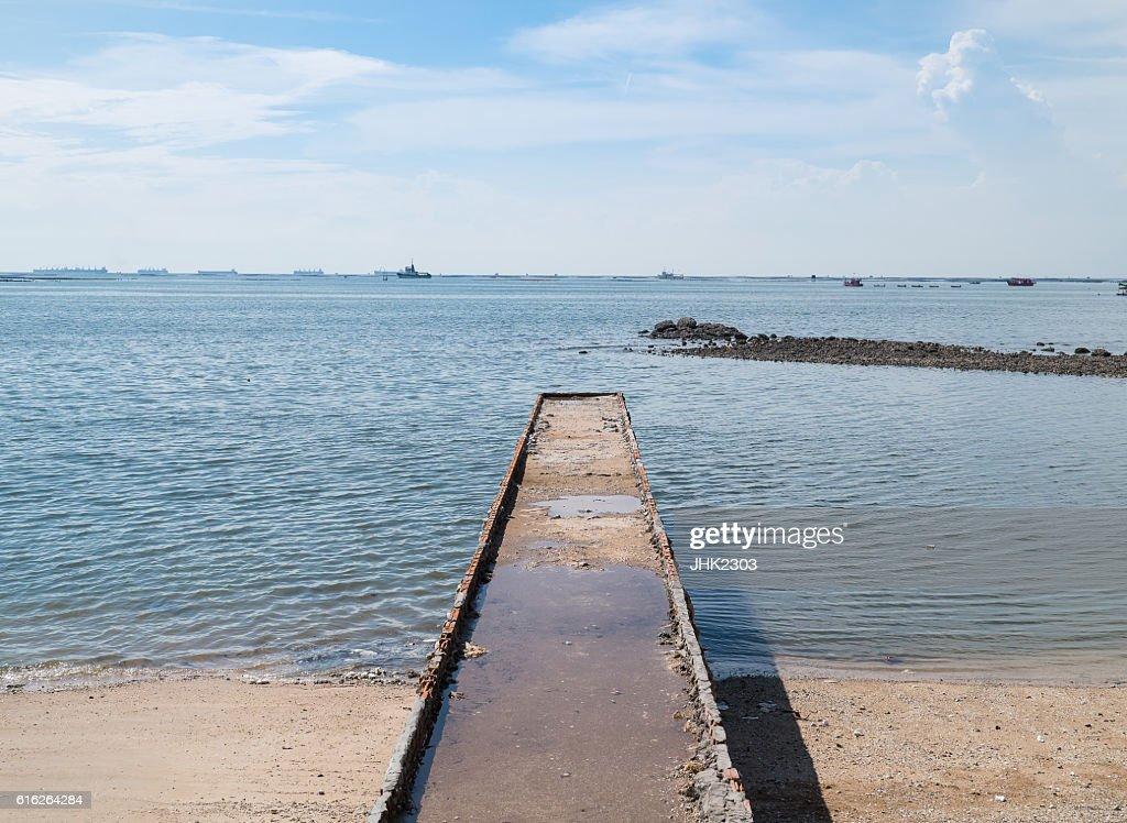 Stone brick jetty to the sea : Stock Photo