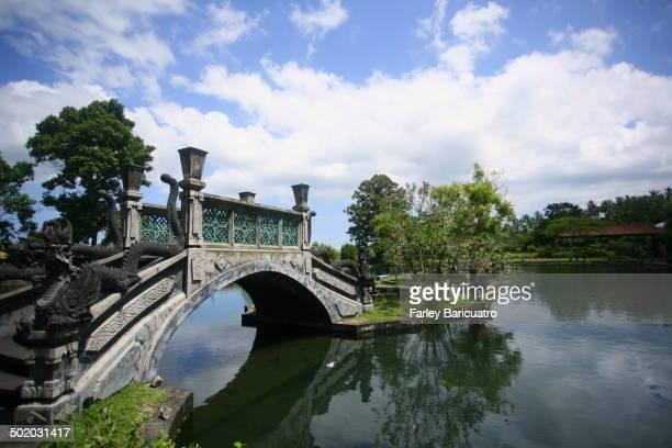CONTENT] stone bridge at the Tirta Gangga the Royal Water Palace in Karangasem Bali
