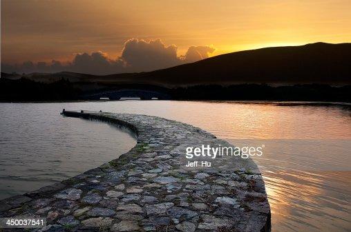 Stone bridge on the calm water of  lake : Stock Photo