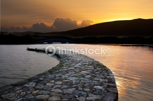 Stone bridge on the calm water of  lake : Stock Photo