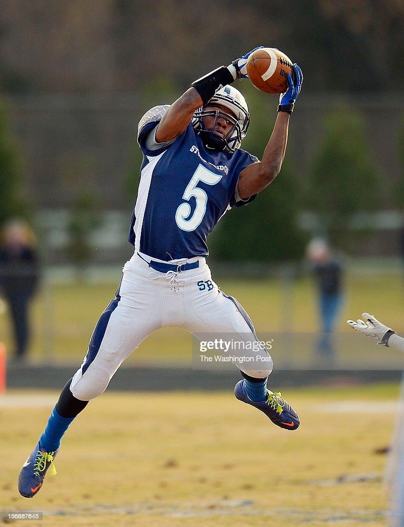 Stone Bridge's CB Rassaun Goldring grabs a 3rd quarter interception as Stone Bridge defeats Yorktown 69 - 50 in the Virginia AAA Northern Region Division 5 final at Stone Bridge High School in Ashburn VA, November 23, 2012 .