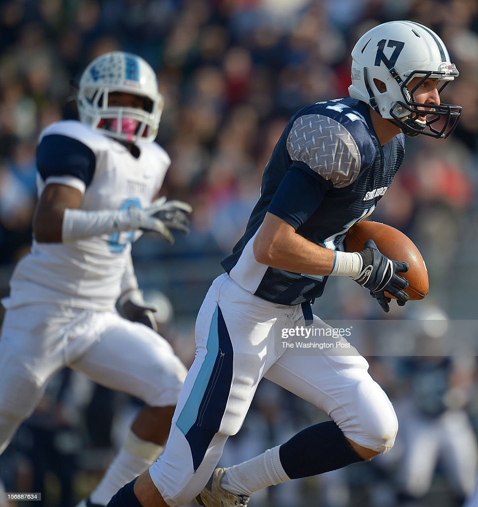 Stone Bridge's WR Jimmy Higgins, right, takes a long 1st quarter pass down to the red zone to set up a TD as Stone Bridge defeats Yorktown 69 - 50 in the Virginia AAA Northern Region Division 5 final at Stone Bridge High School in Ashburn VA, November 23, 2012 .