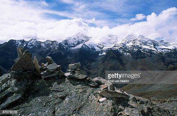 Stone Cairn with Snow-Capped Mountains in the Background