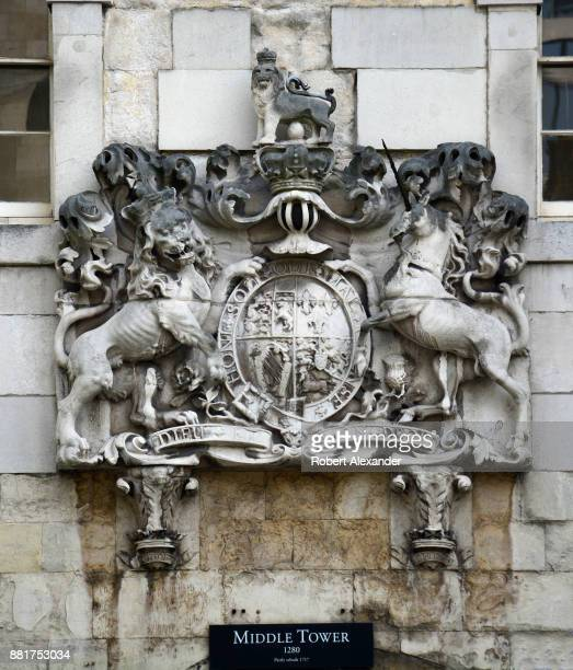 A stone carving of the royal coat of arms of the United Kingdom or the Royal Arms for short is embedded in the wall above the Middle Tower entrance...