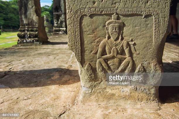 Stone carving on a pillar at Angkor Wat