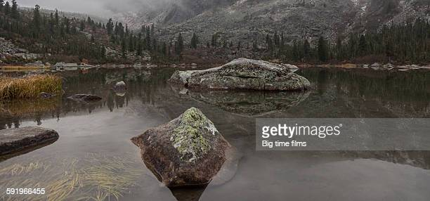 Stone crocodiles of the mountain lake