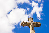 Stone cross with sky