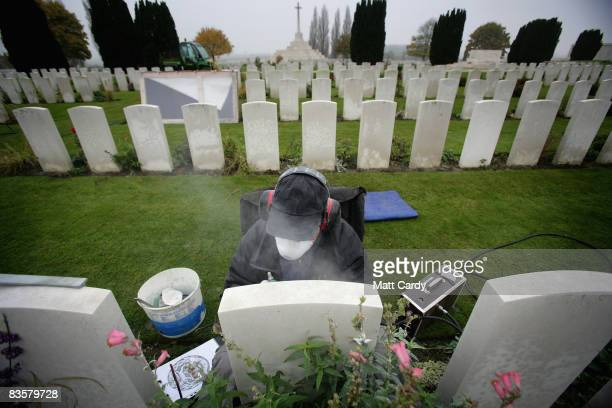 A stone cutter working for the Commonwealth War Graves Commission reengraves a Portland stone headstone in the Tyne Cot Cemetery the largest...
