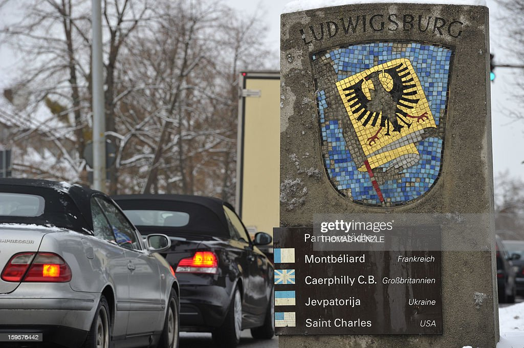 A stone decorated with the city arms of German city of Ludwigsburg displays the names of its international sister cities on a road in Ludwigsburg, southwestern Germany, on January 16, 2013, as the partnership between Ludwigsburg and Montebeliard was the first German-French citypartnership, contracted in 1950, as part of the Elysee Treaty. A ceremony is planned for January 22 in Berlin with current French and German governments and parliaments to mark the signing of the Elysee treaty that formalised Franco-German cooperation. AFP PHOTO / THOMAS KIENZLE