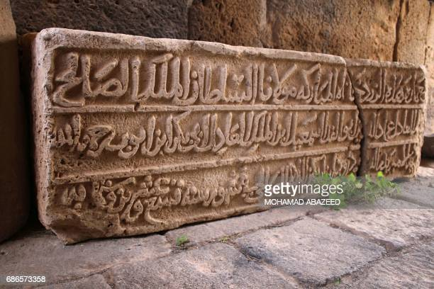 A stone engraved with Islamic texts is seen at the ancient Roman amphitheatre of Bosra alSham which is listed as a UNESCO world heritage site in the...