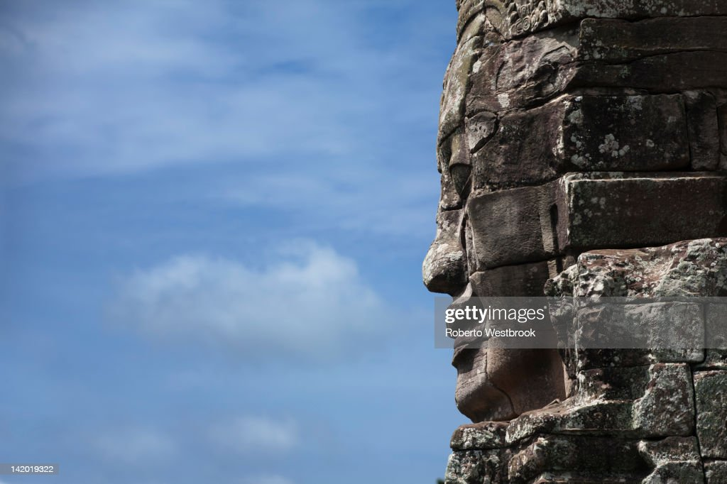 Stone face in Avalokiteshvara, Bayon Temple : Stock Photo