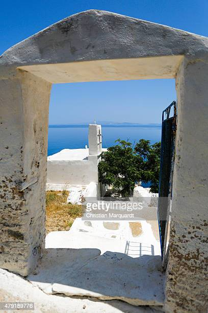 A stone gate entrance to a old Greec orthodox church next to the town of Apollonia on the Aegean Sea on June 17 2015 in Sifnos Greece Sifnos is a...