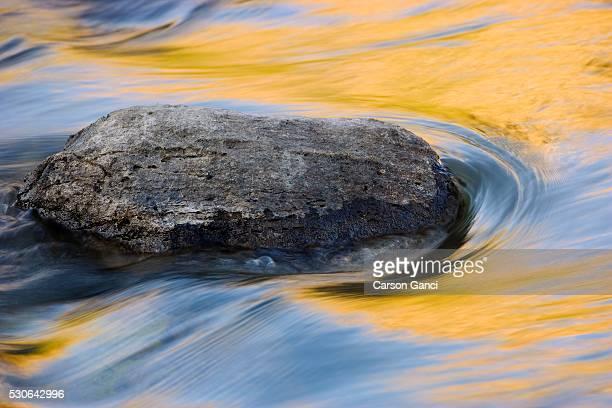 Stone in moving water