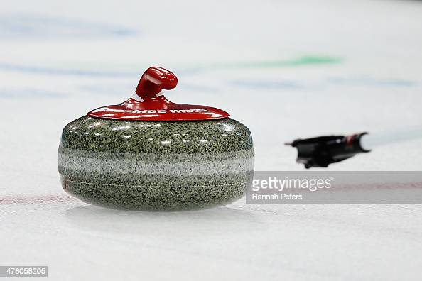A stone is pushed during the wheelchair curling round robin session 9 match between Great Britain and Russia on day five of Sochi 2014 Paralympic...