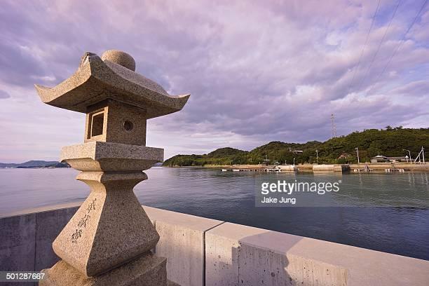 Stone lantern overlooking bay on Naoshima Island