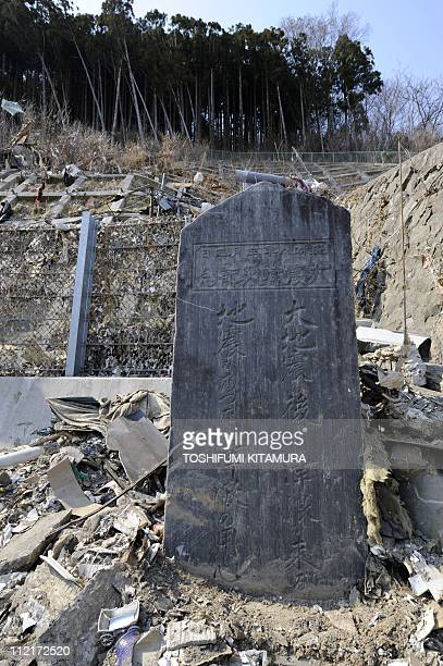 A stone monument dating from March 3 1933 warns of the danger of earthquake and tsunamis stands in Onagawa town Miyagi prefecture on April 14 2011...